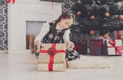 Beautiful girl unwrapping christmas presents Stock Image