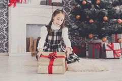 Beautiful girl unwrapping christmas presents Royalty Free Stock Photo