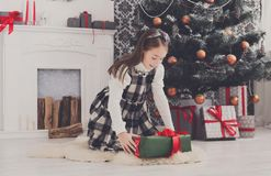 Beautiful girl unwrapping christmas presents Stock Photo