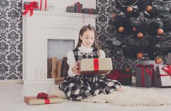 Beautiful girl unwrapping christmas presents Stock Photography