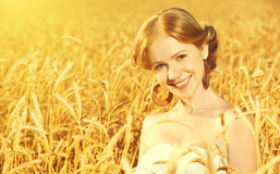 Beautiful happy girl in wheat field in summer Royalty Free Stock Photography