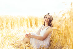 Young, emotional and happy woman in a meadow of rye. Beautiful g Royalty Free Stock Photography