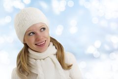 Beautiful happy girl in winter hat and scarf Royalty Free Stock Photography