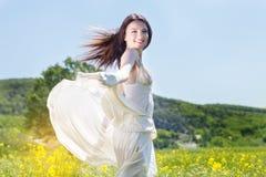 Beautiful happy girl in the yellow field Stock Photo