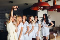 Beautiful happy girls gathering together for chilling out. stock photos