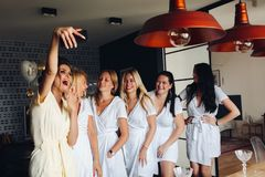 Beautiful happy girls gathering together for chilling out. stock images