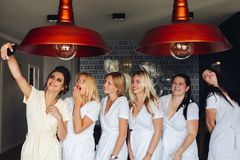 Beautiful happy girls gathering together for chilling out. stock photography