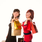 Beautiful happy girls with many shopping bags. Shopping concept. Royalty Free Stock Photography