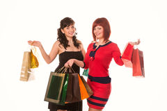 Beautiful happy girls with many shopping bags. Shopping concept. Stock Images