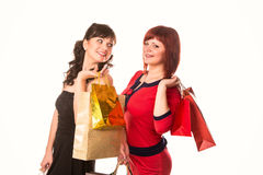 Beautiful happy girls with many shopping bags. Shopping concept. Stock Photos
