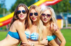 Beautiful happy girls on summer party. Three beautiful happy girls on summer party Royalty Free Stock Photography