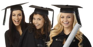 Beautiful happy graduates Stock Photo