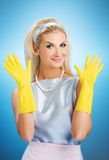 Beautiful happy housewife. With rubber gloves stock photos