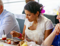 Beautiful happy indian bride eating on wedding dinner. Royalty Free Stock Images