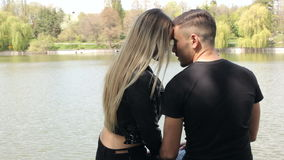 Beautiful happy inlove couple in the park stock video