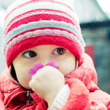 Beautiful happy kid in the red jacket Royalty Free Stock Images