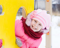 Beautiful happy kid in the red jacket Stock Images