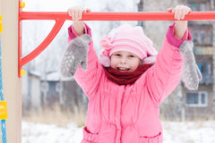 Beautiful happy kid in the red jacket Royalty Free Stock Photography