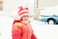 Beautiful happy kid in the red jacket Royalty Free Stock Photo