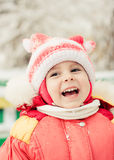 Beautiful happy kid in the red jacket Stock Photos
