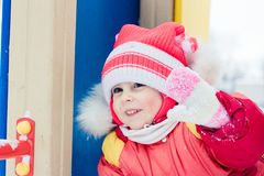 Beautiful happy kid in the red jacket. Stock Photography
