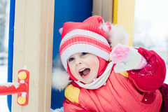 Beautiful happy kid in the red jacket. Stock Photo
