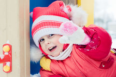 Beautiful happy kid in the red jacket. Royalty Free Stock Photo