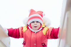 Beautiful happy kid in the red jacket Royalty Free Stock Photos
