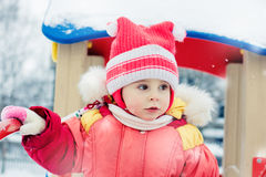 Beautiful happy kid in the red jacket Royalty Free Stock Image