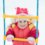 Beautiful happy kid in the red jacket Stock Photography