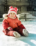 Beautiful happy kid in the red jacket. Stock Photos