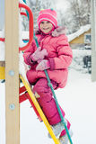 Beautiful happy kid in the red jacket. In the winter outdoors stock images