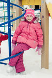 Beautiful happy kid in the red jacket. In the winter outdoors royalty free stock photography