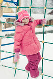 Beautiful happy kid in the red jacket. In the winter outdoors stock photo