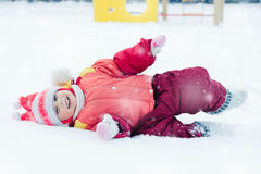 Beautiful happy kid in the red jacket Stock Photo