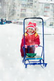 Beautiful happy kid in the red warm clothing. Royalty Free Stock Photos
