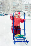 Beautiful happy kid in the red warm clothing. Stock Photos