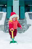 Beautiful happy kid in the red warm clothing. Royalty Free Stock Image
