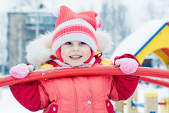 Beautiful happy kid in the red warm clothing. Stock Photography