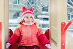 Beautiful happy kid in the red warm clothing. Stock Image