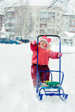 Beautiful happy kid in the red warm clothing. Royalty Free Stock Photography