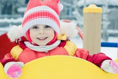 Beautiful happy kid in the red warm clothing Royalty Free Stock Images