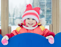 Beautiful happy kid in the red warm clothing Stock Image