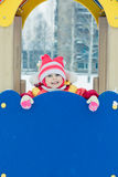 Beautiful happy kid in the red warm clothing Stock Photo
