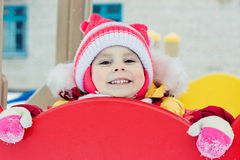 Beautiful happy kid in the red warm clothing Stock Photos