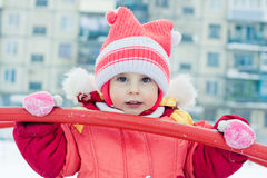 Beautiful happy kid in the red warm clothing. Stock Images