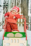 Beautiful happy kid in the red warm clothing. Royalty Free Stock Photo