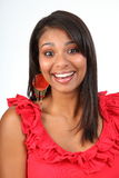 Beautiful happy laughing Latino girl in red royalty free stock photos