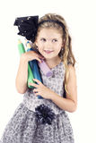 Beautiful happy little girl carrying big crayons Royalty Free Stock Images