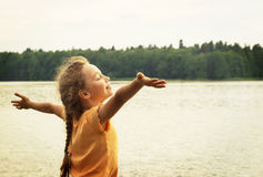 Beautiful happy little girl enjoying summer outdoors Royalty Free Stock Images